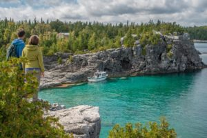 The tall limestone cliffs and turquoise water of the Bruce Peninsula provide a variety of recreational opportunities for residents and visitors alike. Credit: Scott Parker